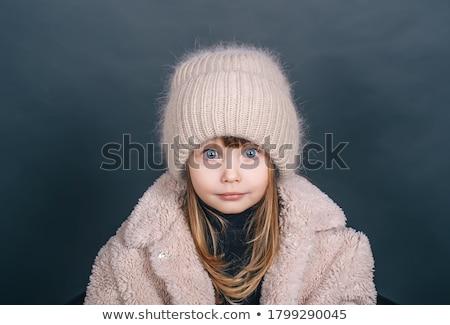 children kid winter girl with cap coat and fur smiling stock photo © lunamarina
