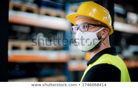 Construction worker wearing yellow hard hat stock photo © stockyimages