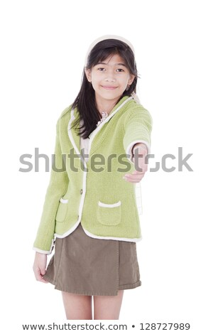 Girl in lime green sweater extending hand in greeting Stock photo © jarenwicklund