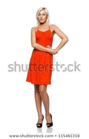 Vrouw permanente rode jurk handen heupen mode Stockfoto © wavebreak_media