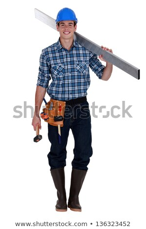 Construction worker carrying metal bean and hammer Stock photo © photography33