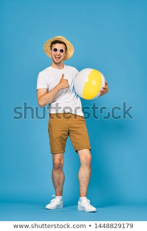 Woman Holding Beachball Stock photo © piedmontphoto