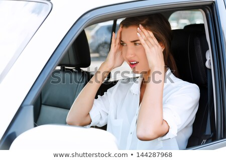 Troubles on the road, girl touches her forehead by hands Stock photo © Nobilior