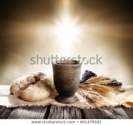 Bor kenyér kehely darab nyitva Biblia Stock fotó © MKucova
