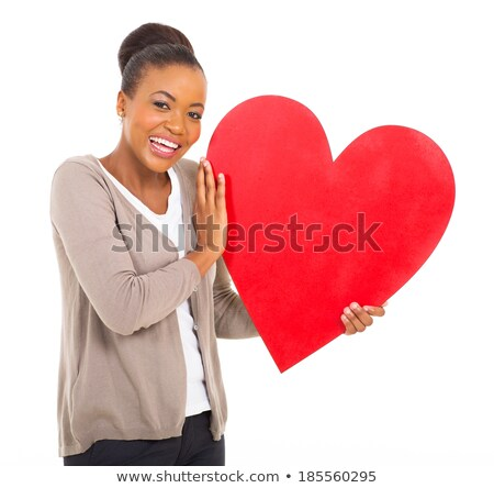 Smiling lady holding love paper heart stock photo © stockyimages
