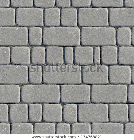 Gray paving cobblestone blocks pattern background. Stock photo © latent