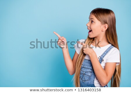 Stock photo: Beautiful girl is pointing up with her hand