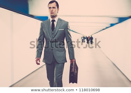 man in classic suit with briefcase walking through corridor stock photo © nejron