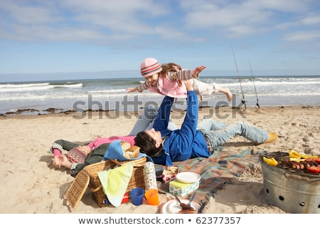 Family Having Picnic On Winter Beach Stock photo © monkey_business