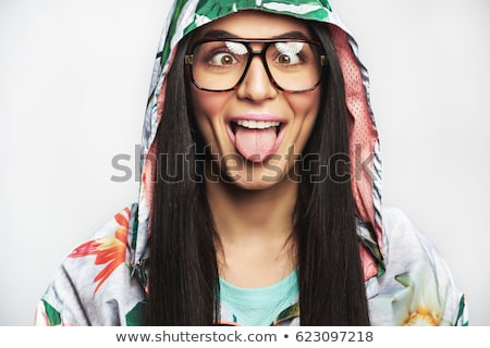 Indian young woman sticking out her tongue Stock photo © bmonteny