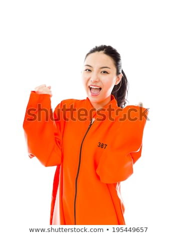 Stock foto: Young Asian Woman Celebrating Success In Prisoners Uniform