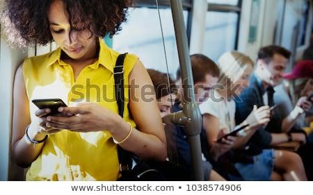 женщину смартфон друзей домой Сток-фото © HASLOO