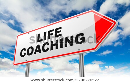 Stok fotoğraf: Life Coaching Inscription On Red Road Sign