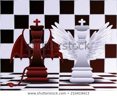 Rey del ajedrez ángel diablo fondo negro oscuro Foto stock © carodi