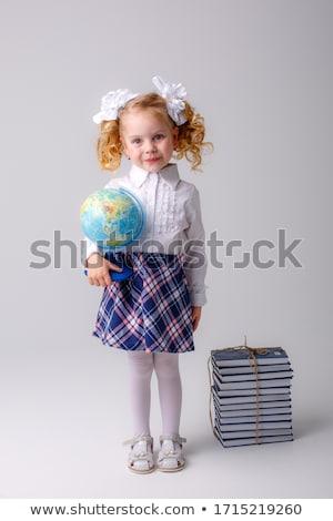 smiling young schoolgirl with a globe stock photo © stryjek