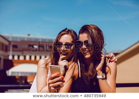 Beautiful chic young girl posing for a selfie Stock photo © stryjek