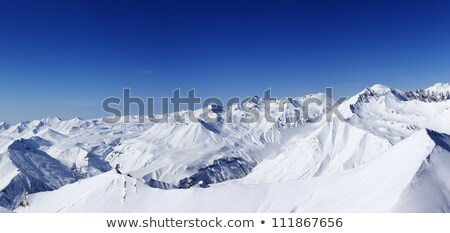 snowy mountains and ski slope at nice day stock photo © bsani
