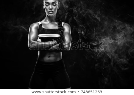 young beautiful sport woman black and white image stock photo © deandrobot