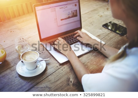Young Bussiness woman opening her laptop Stock photo © hsfelix