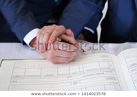 close up of male gay couple hands and wedding ring Stock photo © dolgachov