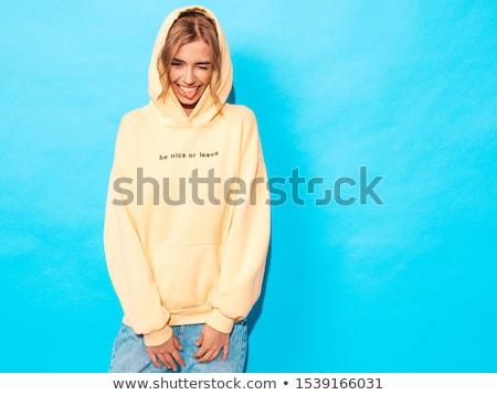 Сток-фото: случайный · сексуальная · женщина · позируют · серый · студию · улыбка