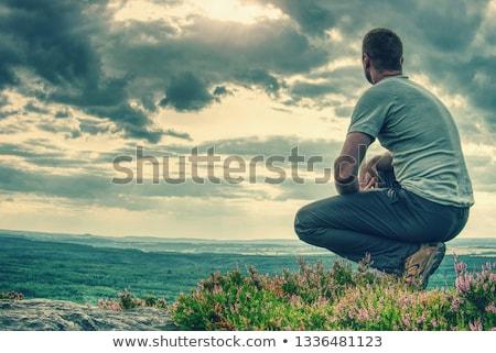 Férfi domboldal ősz tájkép ül szabadtér Stock fotó © Kotenko