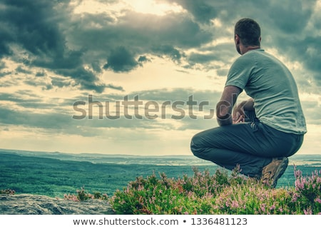 Hombre ladera otono paisaje sesión aire libre Foto stock © Kotenko