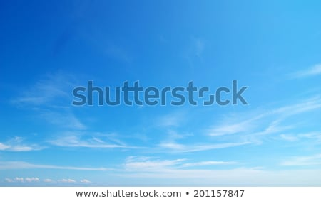 Fleecy clouds on blue sky Stock photo © tetkoren