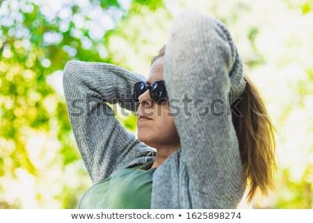Csábító fiatal nő kezek mögött fej szépség Stock fotó © deandrobot