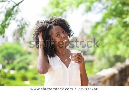 Pretty woman tousled hair Stock photo © lovleah