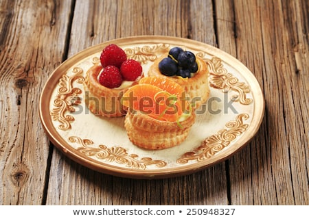 Vla room gebak shell vruchten oranje Stockfoto © Digifoodstock