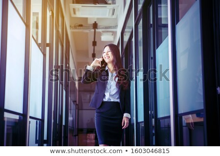 business woman amused by someone on the phone stock photo © giulio_fornasar