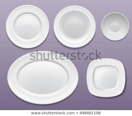 Flat oval white porcelain plate Stock photo © Digifoodstock