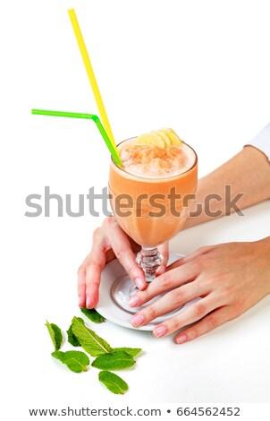Closeup shot of banana smoothie in a big glass Stock photo © Nobilior