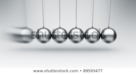 Closeup Of Newton Balls With Swinging Metal Spheres Stock photo © diego_cervo
