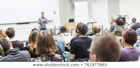 A group listen to a speaker Stock photo © IS2