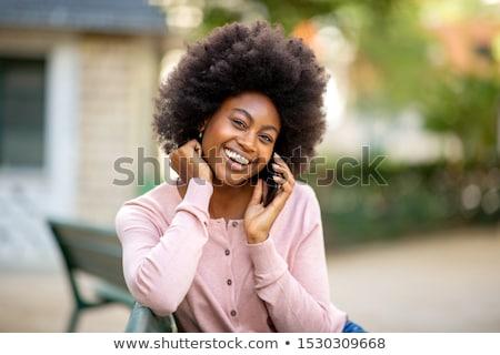 Woman talking on mobile phone in park Stock photo © stevanovicigor