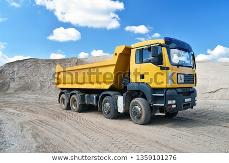 Stock photo: Dumping truck at the construction site