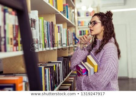 boek · bibliotheek · vrouwelijke · plank - stockfoto © vlad_star