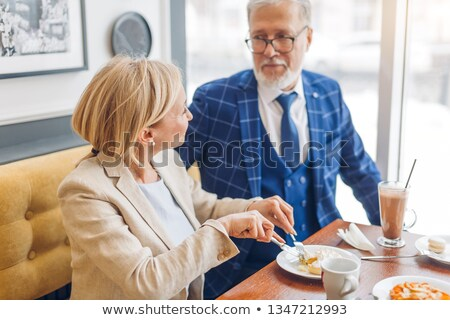 mature man is offered a piece of cake. Stock photo © IS2
