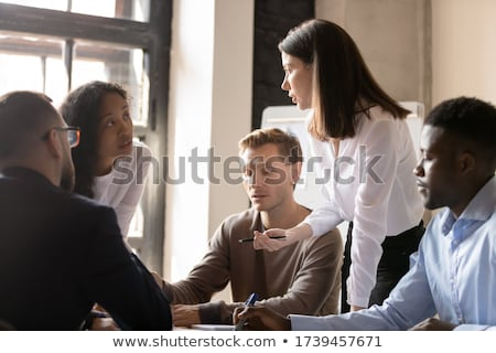 Group of people listening to woman Stock photo © IS2