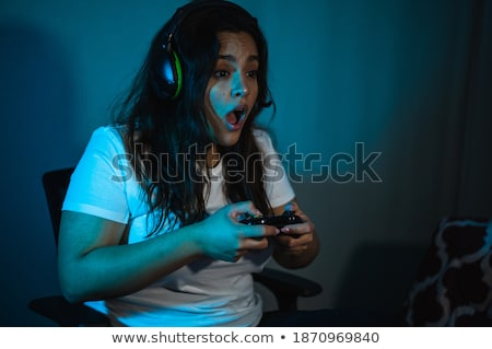 Happy girl with headset next to computer Stock photo © IS2