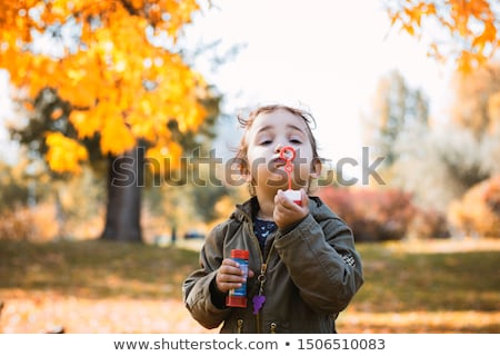 Girl using a bubble wand Stock photo © IS2
