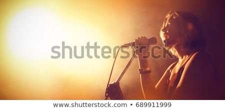 Female singer with microphone Stock photo © IS2