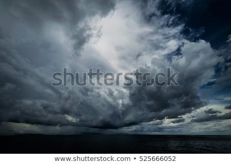 Donkere wolken Open oceaan tropische orkaan Stockfoto © ixstudio