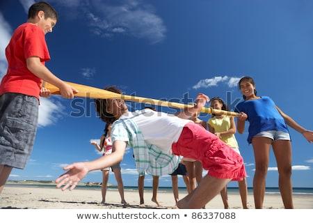 Limbo Dance on the Beach Stock photo © bluering