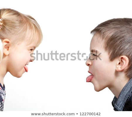 Brother and sister sticking tongues out at each other stock photo © monkey_business