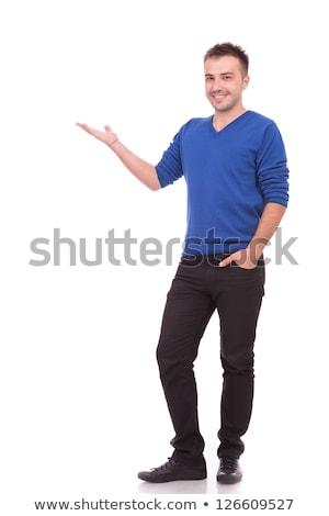 Egészalakos kép fiatal lezser férfi bemutat Stock fotó © feedough