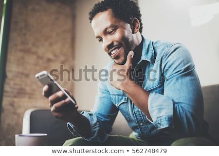Stok fotoğraf: Genç · işadamı · cep · telefonu · ofis · modern · Bina
