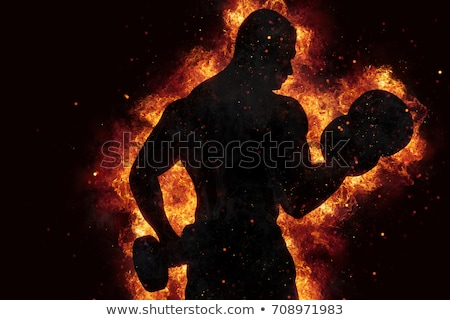 Stock photo: Athletic man training biceps at the gym with fire effect